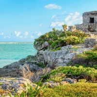 View of Tulum ruins, Mexico.Pre-columbian Mayan city.View of God of Winds Temple.Taken outdoors, on a sunny day, no people.